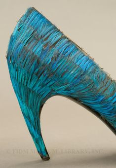 Evening shoes (1959) designed by Roger Vivier for Christian Dior. Kingfisher feathers & leather. via FIDM