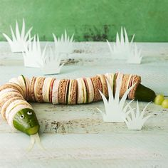 Snakey sandwiches. This is a really versatile idea, so use it as a blueprint and vary the fillings and the size to suit your child. It's an amazing way to serve little party sandwiches, and can even span a whole buffet table. The round snake body needs to be about the same size as the cucumber so it's important to choose a chubby cucumber when shopping, otherwise the sandwiches themselves will have to be tiny! #EveryMilestone