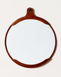 Our wide, oval mirror sits inside a hand-stitched, vegetable tanned leather mirror frame. Leather will darken naturally with age. Hand crafted in Pennsylvania. Oval Mirror, Round Mirrors, Leather Stool, Tan Leather, Leather Furniture, Maple Shade, Sweet Home, Wood Lamps, Stitching Leather