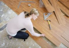 Learn how to install laminate flooring on your own with this simple step-by-step guide that offers tool suggestions and cutting and laying tips. Wood Flooring Options, Diy Wood Floors, Installing Laminate Flooring, Wood Laminate Flooring, Vinyl Plank Flooring, Diy Flooring, Flooring Ideas, Hardwood Floors, Carpet Tiles For Basement