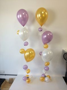 Half bubbles - only 1.6m tall so great for table centrepieces as a little different from the usual balloon arrangement. This one in Pearl White, Lavender and Gold - a soft look and feel.