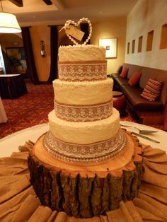 Burlap and Lace, 3 tier rustic wedding cake for Audra and Brian! 10 inch, 8in and 6in, 2 layer rounds, all homemade buttercream with a rustic style technique with burlap, lace and edible pearls finishing it off! https://www.facebook.com/angelas.cakes2011