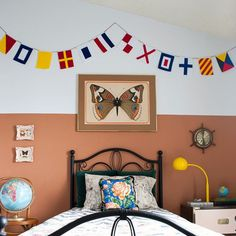 This adorable DIY nautical flag banner was inspired by an expensive Land of Nod version. Tutorial includes FREE printable templates!