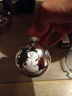 Handpainted acrylic ornament.