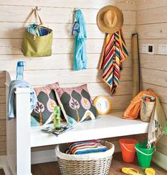 An entryway bench lends extra storage and character. Laundry baskets underneath hold towels or toys, and the addition can multitask as a handy seat or shelf for backpacks, groceries, or boxes.