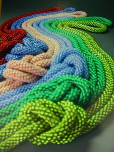 I've been working on some bead crochet ropes on and off.  I love making them.  Above are some I sold.  I cover my thin crochet hooks with p...