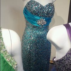 PROM DRESS Beautiful light blue prom dress only worn for a total of 3 hours, in perfect condition, shapes your body and is very comfortable. A little heavy because of all the beading but an amazing look. Dresses