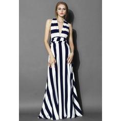 Cette robe vous propulse sous le feu des projecteurs ! Rayures noires et blanches classiques, dos nu avec de longues lanières à nouer à l'arrière. Utilisez votre créativité pour nouer ces nœuds. Peu importe la manière, vous serez toujours la reine de la nuit.   - Lanière à nouer sur le haut du corps  - Taille élastiquée  - Non doublée  - 95% coton, 5% élasthanne - Lavage à la main   Taille (en cm) Longueur Taille XS       108            60-70 S        1...