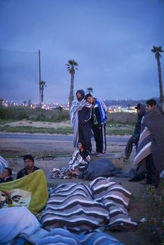 Syrian refugees outside a facility for immigrants in Melilla, Spain.