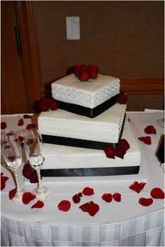 black and white square wedding cake blue ribbon and ...
