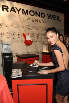 Singer Nicole Scherzinger signing the RAYMOND WEIL watch at the Elle Women in Music event to benefit Save The Music Foundation. Raymond Weil, Women In Music, Nicole Scherzinger, Event Management, In Hollywood, Entertaining, Singers, Benefit, People