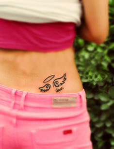 cute comic style angel wing tattoo on the lower back _i would place between shoulder blades and places daughter names in each wing- without halo.