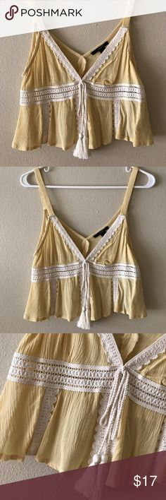 Light Yellow Bohemian Crochet Crop with Tassels **NEW WITH TAGS / NEVER BEEN WORN** This top is so cute for spring & summer paired with a long flowy skirt or your favorite denim shorts! It features beautiful crochet detailing, v-neck & tassels to seal the look  Forever 21 Tops