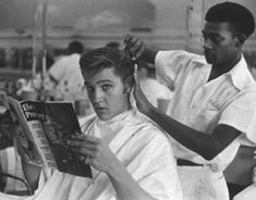 """1956 -- this photo of Elvis getting a haircut at Jim's Barber Shop on Main Street in Memphis, TN was taken by journalist Lloyd Shearer in the last week of July on assignment for """"Parade"""" magazine. Barbershop Design, Elvis Presley Photos, Daily Beauty, Graceland, Belle Photo, Memphis, Rock N Roll, The Past, Hair Cuts"""