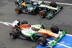 NICO HULKENBERG, SAHARA FORCE INDIA FORMULA ONE TEAM AND VITALY PETROV, CATERHAM F1 TEAM