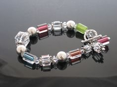 Judy's Cane Glass Bracelet: make your own cane glass, crystal and silver bracelet with this easy DIY tutorial.  Bead World - Downloadable Instructions