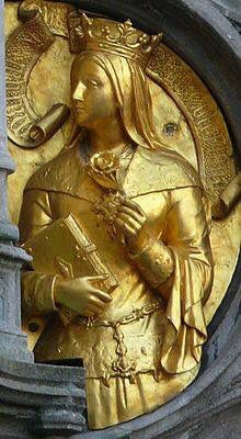 Gilded statue of Margaret of York, supporting Mary of Burgundy, on the façade of the Basilica of the Holy Blood in Bruges, 1529-33
