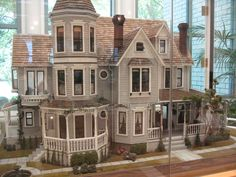 Pretty dollhouse -- eye candy.  Just a link to the picture.  Love the sidewalk wrapping around the house.