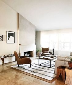 9 Living Room Fireplace Ideas That Are White Hot Modern Living Room With Concrete Fireplace And Angled Ceiling Concrete Fireplace, Farmhouse Fireplace, Modern Fireplace, Fireplace Wall, Living Room With Fireplace, Fireplace Ideas, Rustic Fireplaces, Fireplace Surrounds, High Ceiling Living Room
