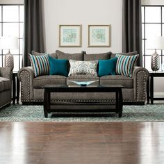 Perfect for transitional spaces the Aquarius is stylish and comfortable. You'll enjoy relaxing on environmental friendly 1.9 lb density foam cushions covered in a gray durable chenille fabric while the nailhead trim makes a chic statement. Designer accent pillows in different patterns and sizes a...