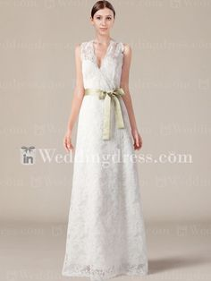 Romantic lace wedding dress features winsome V-neck with scallop-shaped edges and contrasting waistband.