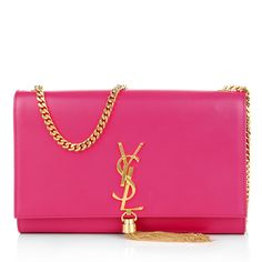 Glamorous: the 'Saint Laurent Monogramme Clutch Tassel' in bubble gum can be the perfect companion for Valentine!  Fashionette.com