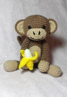 I crocheted this happy  little amigurumi monkey and his banana using a pattern designed by Betsi Brunson.  Link to the pattern is here: http://www.ravelry.com/patterns/library/amigurumi-monkey-with-banana I didn't change the pattern much at all. However, I made the banana a clip-on by sewing a hair pin onto the banana and clipping it onto the monkey's hand.