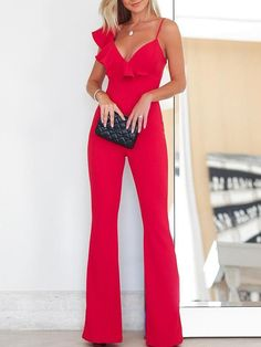 Step out and look sexy stylish in this solid red ruffle asymmetrical neck flared jumpsuit.