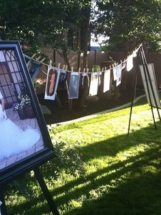 a clothes line with pictures from all their ancestors and their wedding photos.