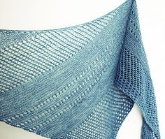 Loved knitting a bias shawl for a change, after a lot of top down triangles. This shape is so wearable and very fun to knit.  With all those eyelets the fabric is really airy and delicate.  Finishe...