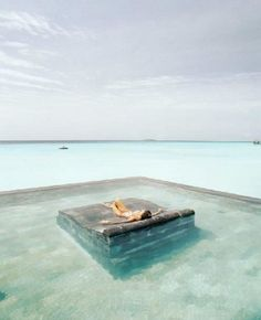 Why yes, I would like a stone bed in a pool in the middle of the ocean. Someone ship me to Bali! Vacation Destinations, Dream Vacations, Vacation Spots, Vacation Travel, Vacation Places, Travel Deals, Travel Guide, Places To Travel, Places To See