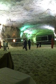 This looks pretty legit. Sand Volleyball courts in a cave!  Now THAT takes some good control!