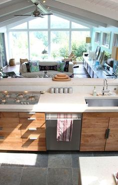 "Love the kitchen over the living room.  I would want it on a much smaller scale.  The only downfall would be carrying groceries.  The door would have to be on the upper level coming into the kitchen so you weren't carrying ""up"""