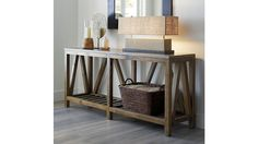 Shop Bluestone Occasional Tables. Each unique table base is handcrafted of pine reclaimed from abandoned buildings, referencing traditional farmhouse construction with angled struts and a slatted lower shelf.