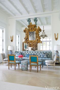 Distinctly Different: A reflective wall accentuates the ornate shape of an Italian Rococo mirror.