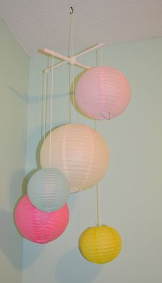 DIY Paper Lantern Crib Mobile! Perfect for little girl or boy nursery, just need to change lanterns to match the room.