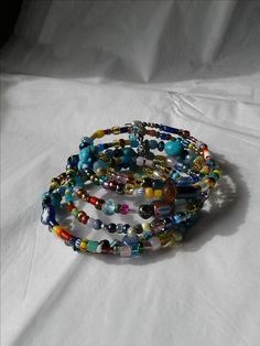 memory wire, practical, easy to wear, fits all, colorful and I made it. so fun. Sprinkles, Soup, Wire, Colorful, Candy, Bracelet, Beads, How To Make, Blog