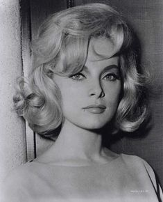 Actress Virna Lisi wearing sexy tousled flip.