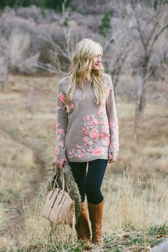 Cozy, easy fall style. Floral-patterned long sweater with fleece leggings or skinny jeans.