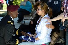 So heartbreaking to see a young widow receiving the flag....I can't even imagine that pain and that strength