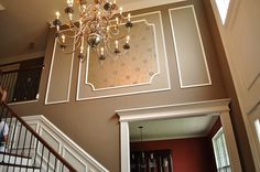 Decorative molding w/ shade lighter paint.