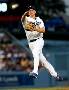 Second baseman Mark Ellis #14 of the Los Angeles Dodgers throws out David Price of the Tampa Bay Rays in the second inning at Dodger Stadium on August 9, 2013 in Los Angeles, California. (Photo by Stephen Dunn/Getty Images)