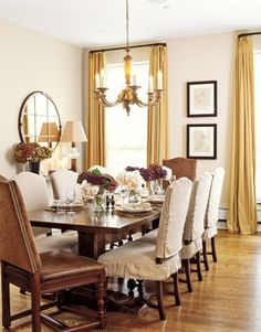 A large custom-made table anchors the dining area, which also serves as a foyer of sorts.