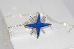 Sirius Star Pendant - Sirius rises late in the dark, liquid sky  On summer nights, star of stars,  Orion's Dog they call it, brightest  Of all..     $68.00
