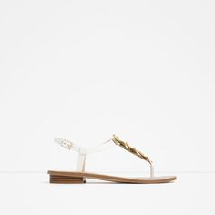 Image 1 of FLAT LEATHER SANDALS WITH FLORAL DETAIL from Zara
