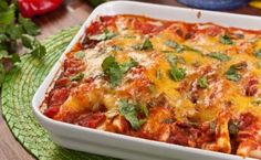 Ingredients : 2 whole wheat tortilla 1 lb ground chicken, or ground turkey 1 can (14 oz) tomato sauce 2 tsp tabasco sauce 1 cup low-fat cheddar cheese, or Mexican blend cheese 1 can (16 oz) fat-free refried beans 1 canola oil cooking spray, 3 sprays 1 baked corn tortilla chips, crushed 1 reduced-fat sour …