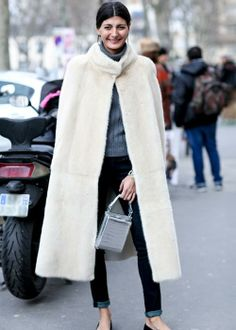 plush cape and skinny jeans