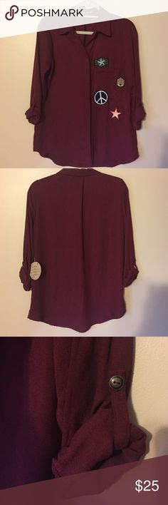 Burgundy Button-down Blouse with Patches The blouse is a hidden button down with peace sign and military patches. Sleeves can be worn with sleeves down or at 3/4 with a button. 02-16-17-12-34-25-15 Gypsie Moondust Tops Blouses