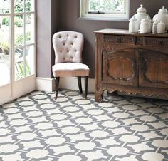 This geo print woukld be a stunning kitchen floor - durable too - Neisha Crosland Parquet @ Harvey Maria