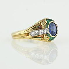 An elusive and quite rare Art Nouveau ring featuring a stunning antique brilliant cut sapphire highlighted by European cut diamonds, calibre cut chrysoprase and basse taille enameling in emerald green. The ring is crafted in 14 karat yellow gold and is sensational. Durand & Co. hallmark. A notable member of the Durand family is the famous Asher B. Durand, a Hudson River Valley painter who worked in the early 19th century.